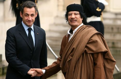 664432_france-s-president-nicolas-sarkozy-greets-libyan-leader-muammar-gaddafi-in-the-courtyard-of-the-elysee-palace-in-paris